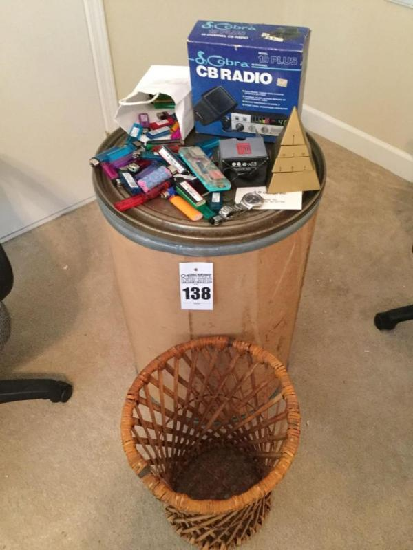 Cardboard tube, CB Radio, collection of lighters, watch et
