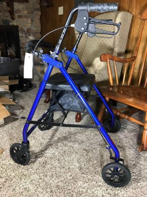 Walking assist. Foldable solid wheels to hand breaks and seat