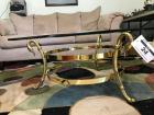 Glass top coffee table with heavy brass frame