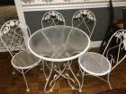 Metal and glass topped table and 4 chairs