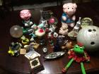 Variety of items: kid decorative pieces/toys, bowling ball, water globes, cookie jars etc.