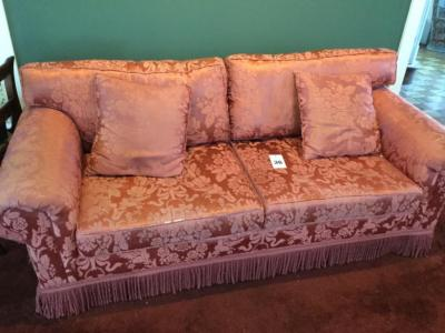 Upholstery sofa with fringe decoration with throw pillows