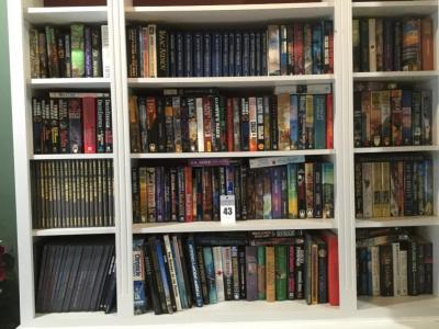 Collection of novels, non-fiction, & sets of books  (Time-Life, Voyage Through the Universe, Isaac Asimov)  (Buyer bring boxes to remove) 100 +