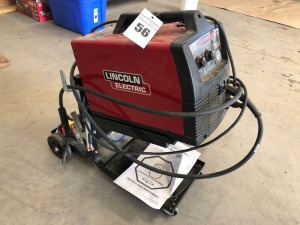 Lincoln Electric EasyMIG 180 with Rolling Stand, Manual, and Accessories
