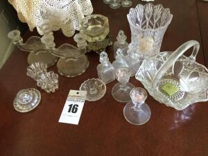 Variety of glass serving items: glass bowl with handle, candle sticks, candle holders, vase, glass jars with glass lids, ring holder, candy dish with lid etc.