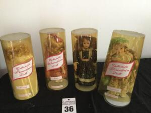 4 collectable Porcelain Dolls in plastic tube all with stands (tubbing is discolored - dolls inside are in good condition)