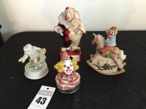 4 music boxes: clown themed