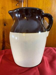 Stoneware pitcher 9 inches tall. A