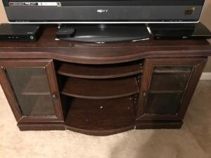 "Entertainment Console with Glass Doors and Adjustable Shelves. 47"" Wide, 25"" Tall, 17"" Deep."