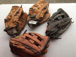 Variety of baseball/softball leather mitts (one newer) - 4 total