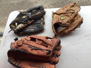 Variety of baseball/softball leather mitts (one newer) - 3 total