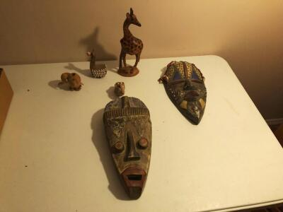 Hand-crafted African masks w/ animal Figures