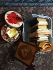 Cookbooks, fruit art, tin with cookie cutters and kitchen accessories - local cookbooks